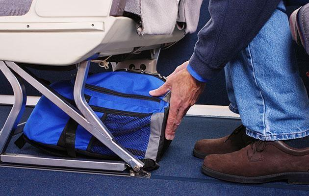 Passengers will be able to bring a carry-on bag which fits under the seat in front of them. Photo: Getty Images.