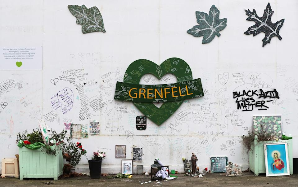 <p>The Grenfell Memorial Wall in the grounds of Kensington Aldridge Academy</p> (PA)
