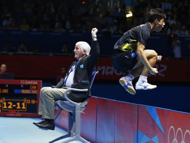 China's Zhang Jike celebrates after defeating China's Wang Hao in their men's singles gold medal table tennis match at the ExCel venue during the London 2012 Olympic Games August 2, 2012. REUTERS/Grigory Dukor (BRITAIN - Tags: OLYMPICS SPORT TABLE TENNIS)