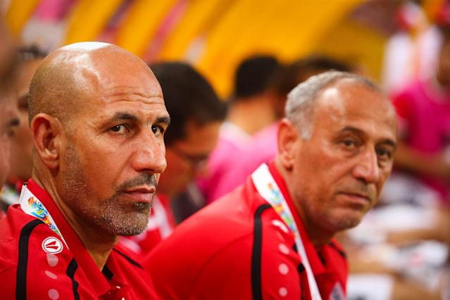 Iraq coach Radhi Shenaishil (left) looks on during the first round Asian Cup match against Japan in Brisbane on January 16, 2015 (AFP Photo/Patrick Hamilton)