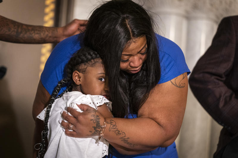 George Floyd's daughter Gianna Floyd, 6, gives her mother Roxie Washington a hug during a press conference at Minneapolis City Hall. Roxie Washington, the mother of George Floyd's six-year-old daughter Gianna Floyd, spoke with her daughter during a press conference at Minneapolis City Hall on Tuesday, June 2, 2020. Washington, of Houston, was joined by George Floyd's friend Stephen Jackson, a former NBA player, and attorneys Justin Miller and Chris Stewart.