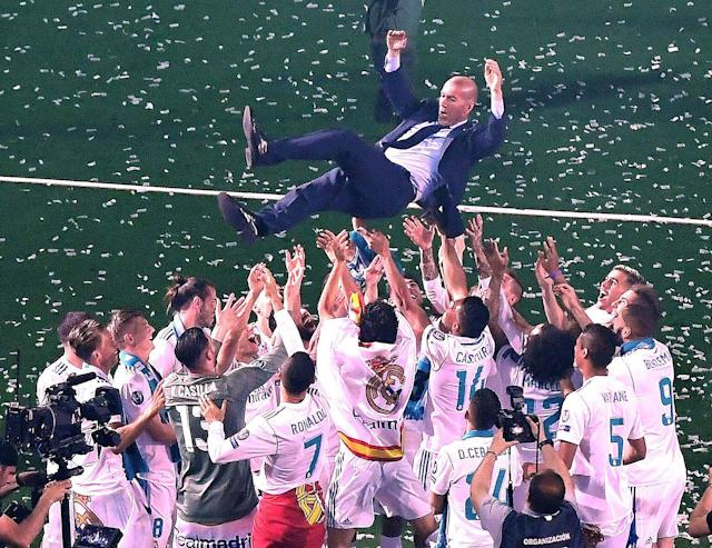 Zidane won three Champions League titles in three seasons with Real Madrid but was often criticized for the club's shortcomings in La Liga. (Getty)