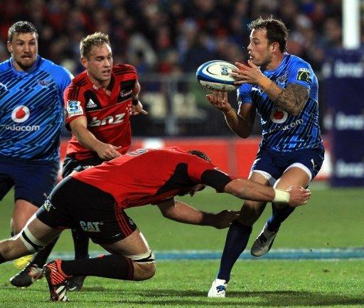 Northern Bulls' Francois Hougaard (R) is tackled by Canterbury Crusaders' Samuel Whitelock during their Super 15 match on July 21. The Crusaders' 28-13 win set them up for a New Zealand derby semi-final next Friday against the Waikato Chiefs