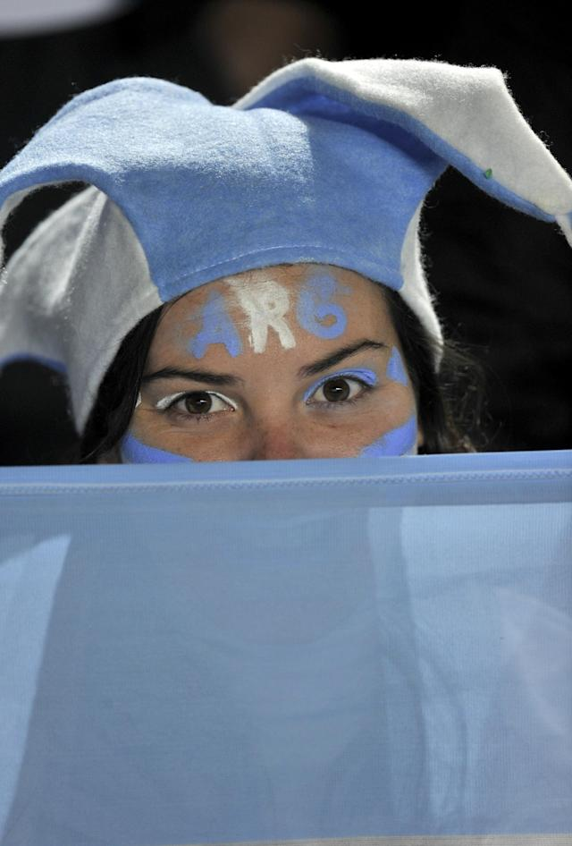 An Argentine supporter cheers her team before the start of a 2011 Copa America Group A first round football match Argentina vs Colombia, at the Cementerio de Elefantes stadium in Santa Fe, 476 Km north of Buenos Aires, on July 6, 2011. AFP PHOTO / OMAR TORRES (Photo credit should read OMAR TORRES/AFP/Getty Images)