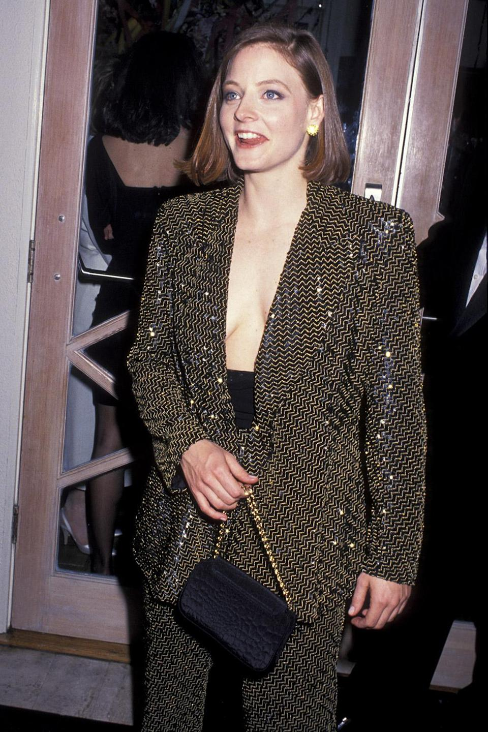 <p>Jodie Foster looked amazing in a black and gold sequin pant suit, nixing a shirt underneath for an edgier look. </p>