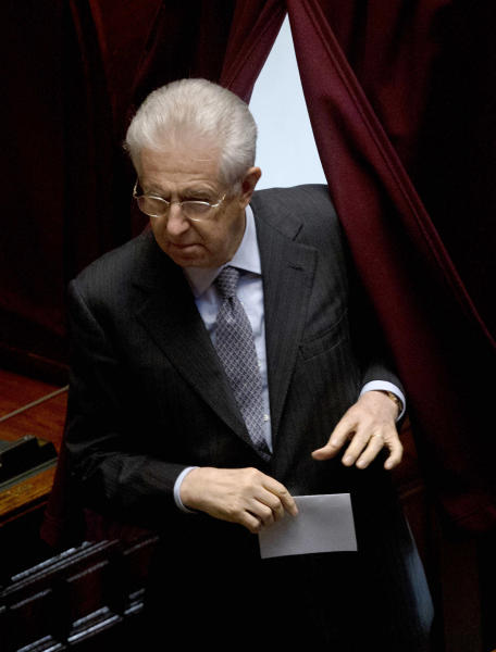 Italian caretaker Premier Mario Monti arrives to vote on a new president whose first job will be to seek the formation of a new government after inconclusive elections, in Rome Thursday, April 18, 2013. Political parties sparred over suitable candidates for the post being vacated by Giorgio Napolitano ahead of the Thursday vote, reflecting divisions that they have been unable to overcome in the more than 50 days since the Feb. 24-25 elections. Napolitano's term expires next month. (AP Photo/Alessandra Tarantino)