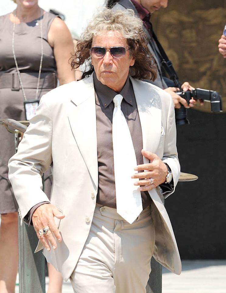 Yep, that's Al Pacino under there! Passersby in Mineloa, New York, surely did a doubletake when they saw the actor on the set of the upcoming Phil Spector biopic film in August. Helen Mirren and Jeffrey Tambor also star in the movie. (08/02/2011)