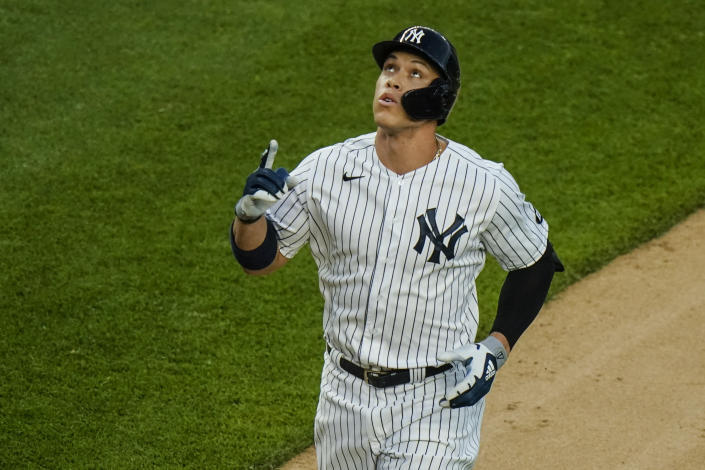 New York Yankees' Aaron Judge reacts as he runs the bases after hitting a two-run home run during the fourth inning of the second game of a baseball doubleheader against the Toronto Blue Jays Thursday, May 27, 2021, in New York. (AP Photo/Frank Franklin II)