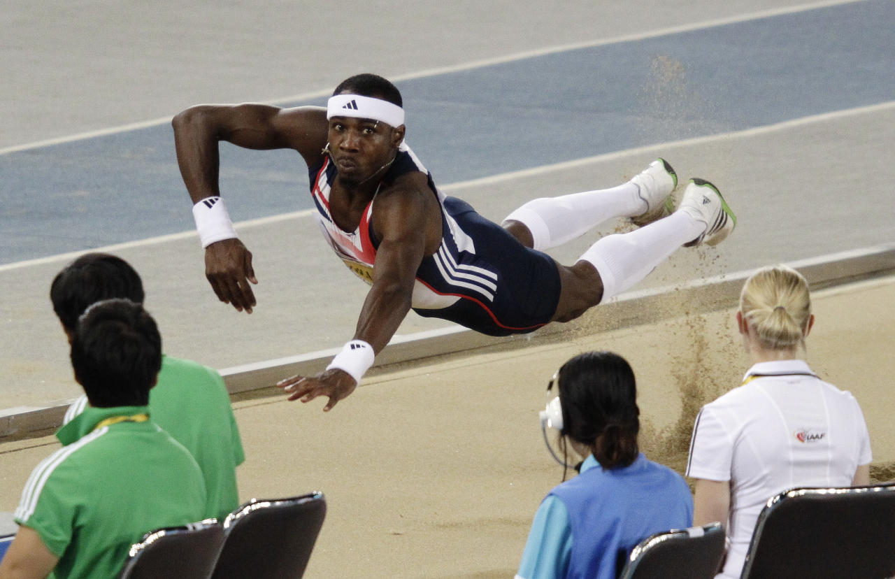 Britain's Phillips Idowu makes an attempt in the Men's Triple Jump final at the World Athletics Championships in Daegu, South Korea, Sunday, Sept. 4, 2011. (AP Photo/Kevin Frayer)