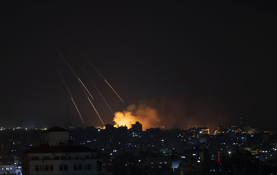 Smoke rises following Israeli missile strikes on Gaza City, Thursday, May 13, 2021. The four-day burst of violence has pushed Israel into uncharted territory — dealing with the most intense fighting it has ever had with Hamas while simultaneously coping with the worst Jewish-Arab violence inside Israel in decades. (AP Photo/Khalil Hamra)