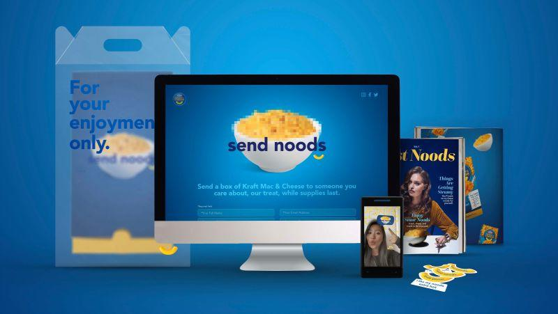 """Product shot of Kraft's """"send noods"""" campaign, including stickers, a magazine, and a box of mac and cheese"""