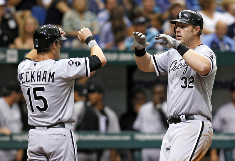 Chicago White Sox's Adam Dunn, right, high-fives Gordon Beckham after Dunn hit a sixth-inning, two-run home run off Tampa Bay Rays starting pitcher Matt Moore during a baseball game, Monday, May 28, 2012, in St. Petersburg, Fla. (AP Photo/Chris O'Meara)