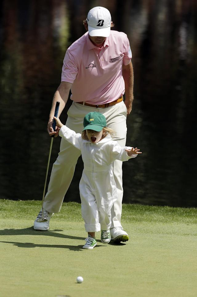 Brandt Snedeker's daughter Lily chases her golf ball on the ninth green during the par three competition at the Masters golf tournament Wednesday, April 9, 2014, in Augusta, Ga. (AP Photo/Chris Carlson)