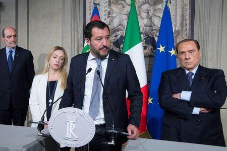 Populist parties win tacit Berlusconi OK to form govt