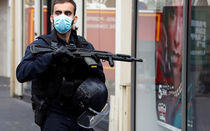 A security officer secures the area after a reported knife attack at Notre Dame church in Nice - ERIC GAILLARD/REUTERS