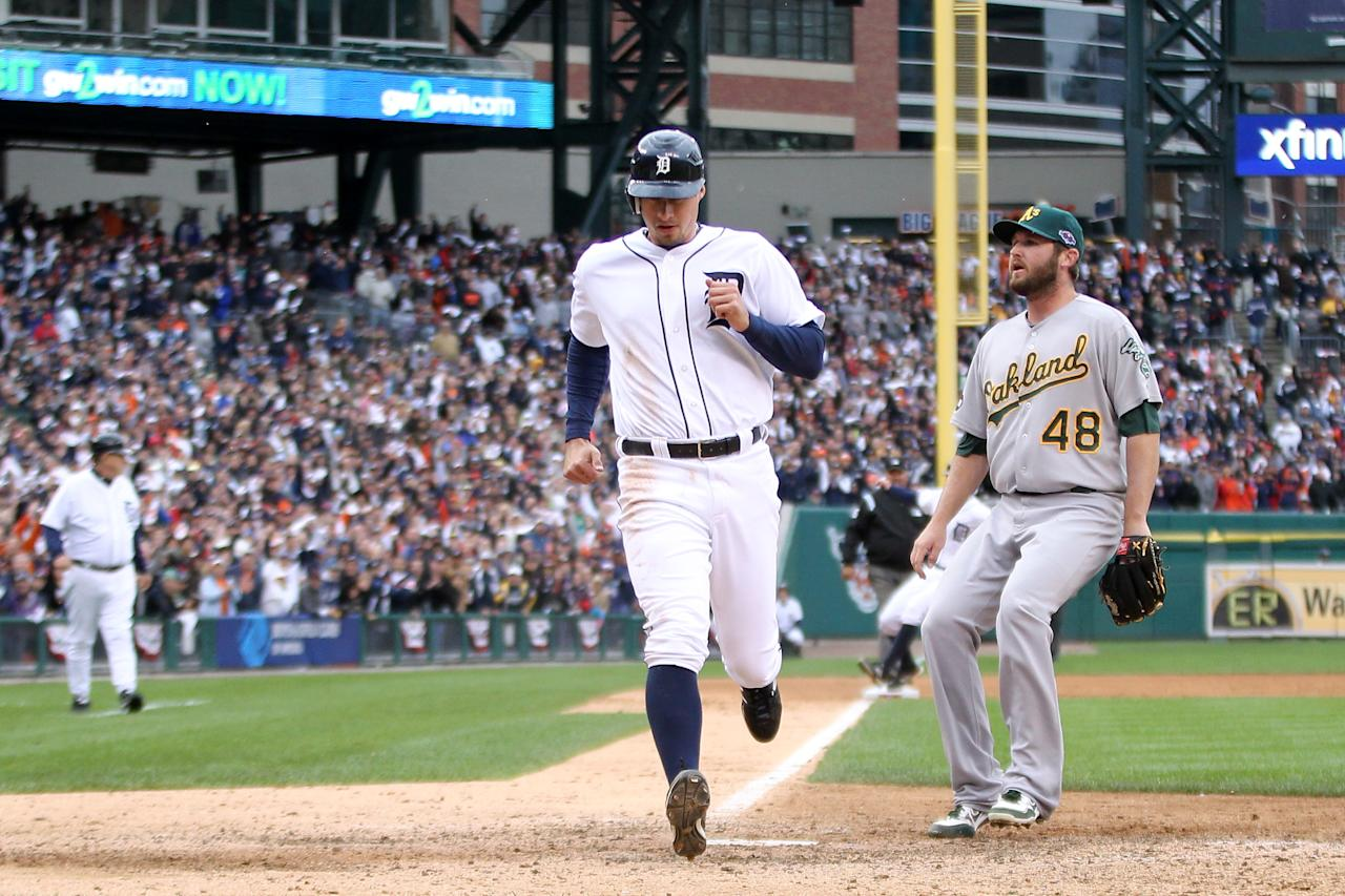 DETROIT, MI - OCTOBER 07:  Don Kelly #32 of the Detroit Tigers scores on a wild pitch thrown by Ryan Cook #48 of the Oakland Athletics in the bottom of the eighth inning during Game Two of the American League Division Series at Comerica Park on October 7, 2012 in Detroit, Michigan.  (Photo by Leon Halip/Getty Images)