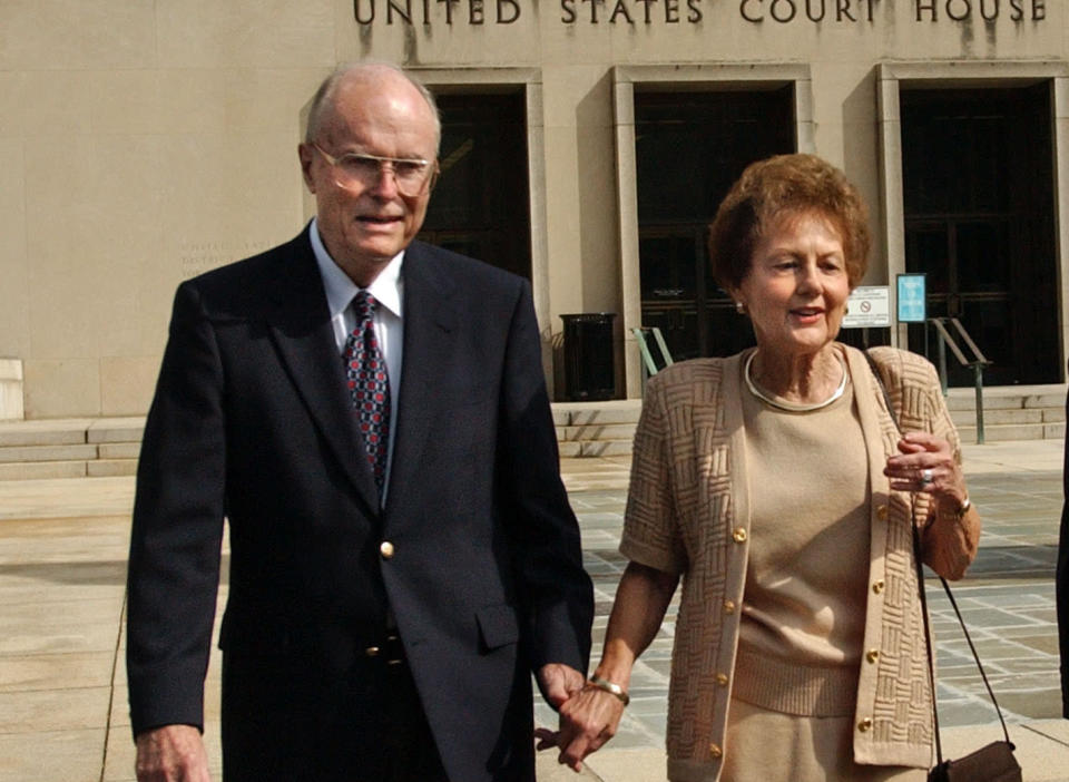 FILE - In this Sept. 2, 2003 file photo, from left, Jack and Jo Ann Hinckley, parents of John Hinckley, leave the U.S. Courthouse in Washington after a hearing regarding John Hinckley's visitation privileges. Jo Ann Hinckley, whose son John attempted to assassinate President Ronald Reagan in 1981 and who spent her final years living with her son in Virginia, has died. Barry Levine, John Hinckley's longtime attorney, confirmed Hinckley's death to The Associated Press on Tuesday, Aug. 3, 2021. (AP Photo/Gerald Herbert, File)
