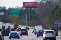 A VOTE billboard is on I-20 West near Lithonia