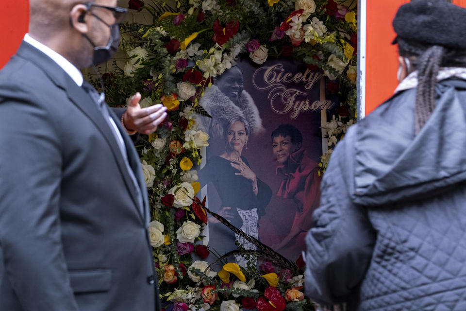 """A photo collage of Cicely Tyson greets people arriving just inside the Abyssinian Baptist Church in the Harlem neighborhood of New York where a public viewing was held Monday, Feb. 15, 2021, for Tyson, who died Jan. 28. Tyson, the pioneering Black actress who gained an Oscar nomination for her role as the sharecropper's wife in """"Sounder,"""" a Tony Award in 2013 at age 88 and touched TV viewers' hearts in """"The Autobiography of Miss Jane Pittman,"""" was 96. (AP Photo/Craig Ruttle)"""