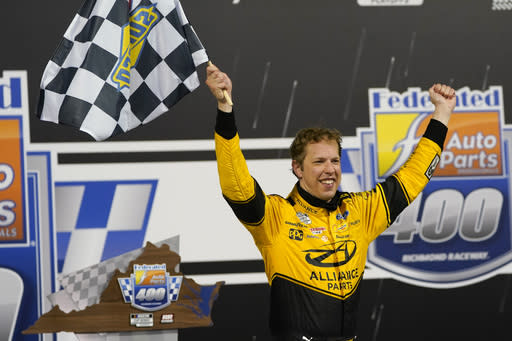 Brad Keselowski (2) celebrates in Victory Lane after winning a NASCAR Cup Series auto race Saturday, Sept. 12, 2020, in Richmond, Va. (AP Photo/Steve Helber)