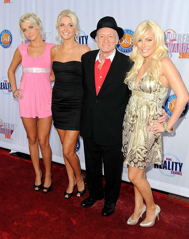 "When Hef walks a red carpet, it's not about what he's got on, but who he's got on his arm. In this case, it's the new cast of ""The Girls Next Door"": Karissa Shannon, Kristina Shannon, and Crystal Harris. Jordan Strauss/<a href=""http://www.wireimage.com"" target=""new"">WireImage.com</a> - October 13, 2009"
