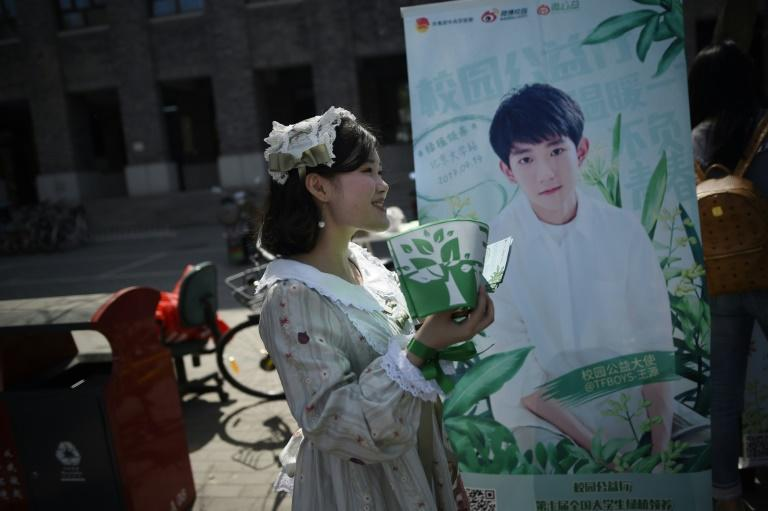 "China's boy band sensation TFBoys ""The Fighting Boys"" are amassing ""mother fans"" who pretend they stars are their children"