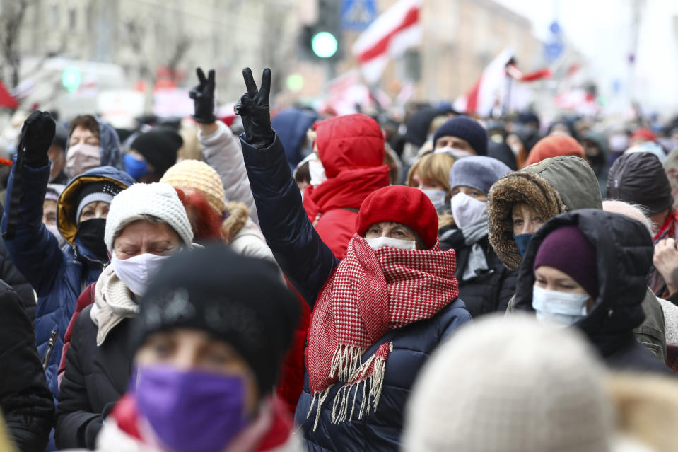 Belarusian pensioners wearing face masks to protect against coronavirus attend an opposition rally to protest the official presidential election results in Minsk, Belarus, Monday, Nov. 16, 2020. Crowds of retirees marched down the streets of the Belarusian capital on Monday, demanding the resignation of the country's authoritarian president and to end the government crackdown on peaceful protesters. (AP Photo)