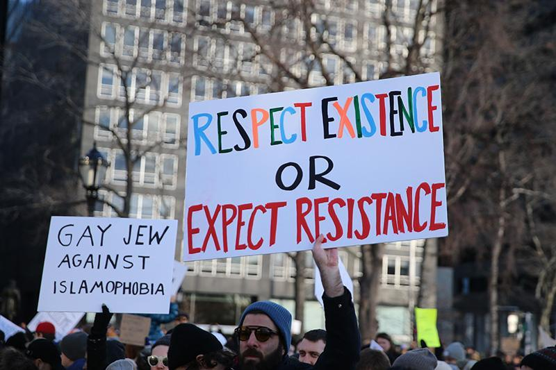 <p>People hold up signs as they gather for a rally in New York's Battery Park in New York, Jan. 29, 2017, protesting President Donald Trump's immigration order. (Gordon Donovan/Yahoo News) </p>