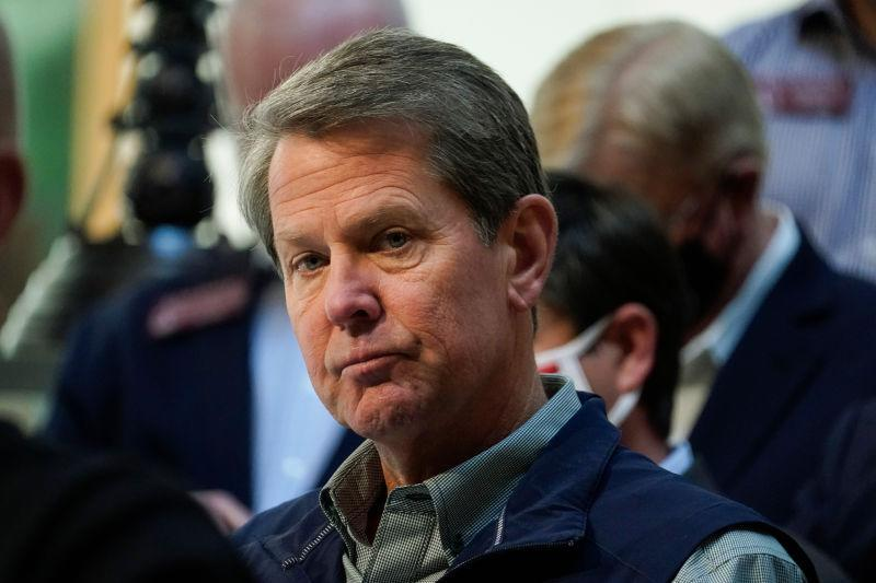 Georgia Gov. Brian Kemp listens to a question during a news conference at the State Capitol on Saturday, April 3, 2021, in Atlanta, about Major League Baseball's decision to pull the 2021 All-Star Game from Atlanta over the league's objection to a new Georgia voting law.