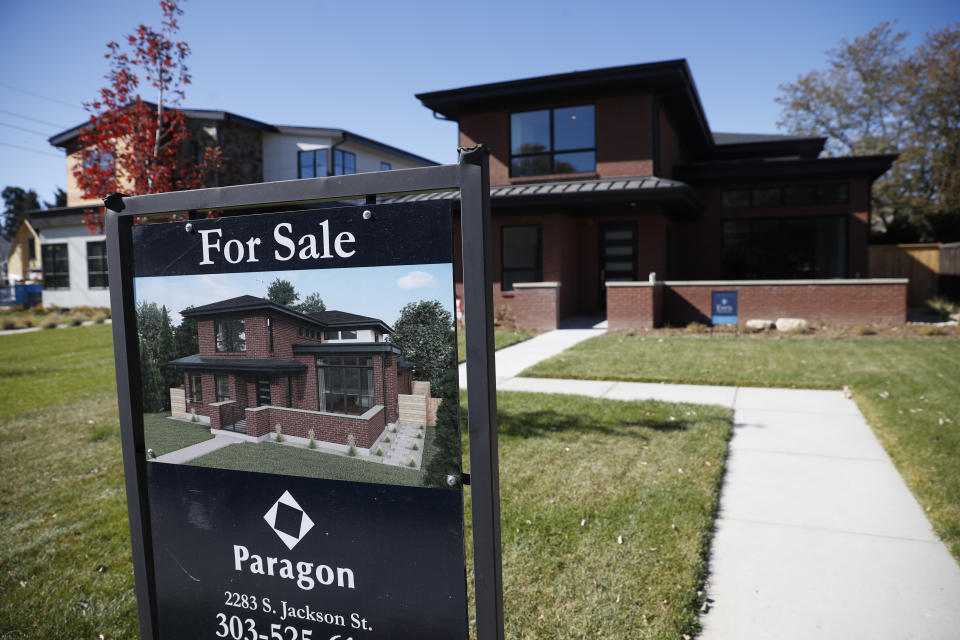 In this Tuesday, Oct. 22, 2019, photograph, a sign stands outside a new home for sale in southeast Denver. (AP Photo/David Zalubowski)