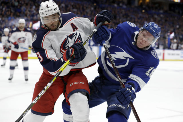 Columbus Blue Jackets defenseman Seth Jones (3) and Tampa Bay Lightning left wing Ondrej Palat (18) collide while chasing the puck during the second period of Game 1 of an NHL Eastern Conference first-round hockey playoff series Wednesday, April 10, 2019, in Tampa, Fla. (AP Photo/Chris O'Meara)