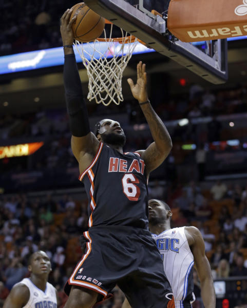 Miami Heat small forward LeBron James (6) goes to the basket against Orlando Magic small forward Maurice Harkless during the first half of an NBA basketball game in Miami, Saturday, March 1, 2014. (AP Photo/Alan Diaz)