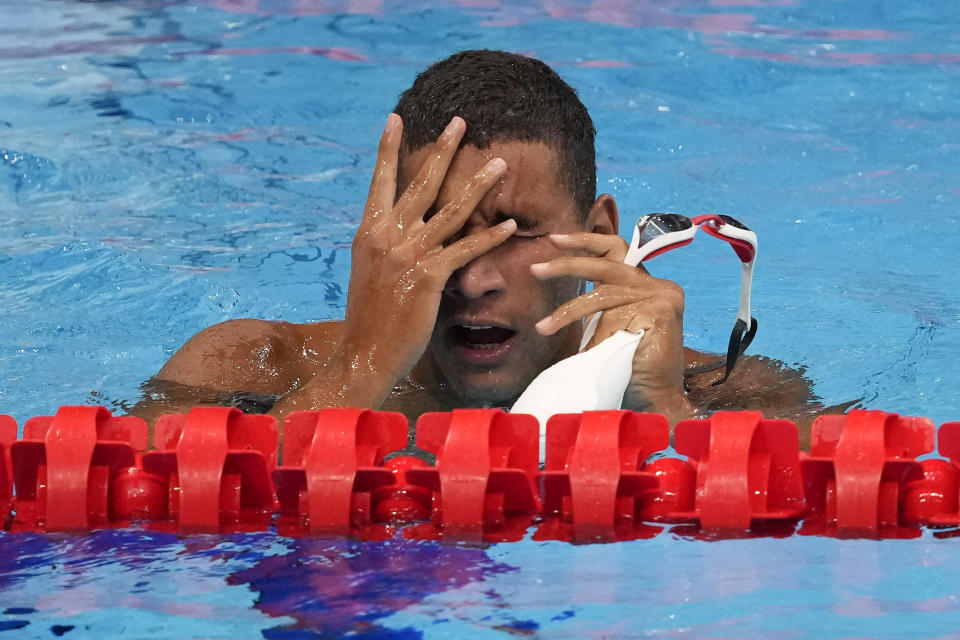 Ahmed Hafnaoui, of Tunisia, reacts after winning the final of the men's 400-meter freestyle at the 2020 Summer Olympics, Sunday, July 25, 2021, in Tokyo, Japan. (AP Photo/Petr David Josek)
