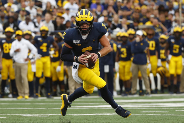 Michigan quarterback Shea Patterson runs for a two-yard touchdown against Rutgers in the first half of an NCAA college football game in Ann Arbor, Mich., Saturday, Sept. 28, 2019. (AP Photo/Paul Sancya)