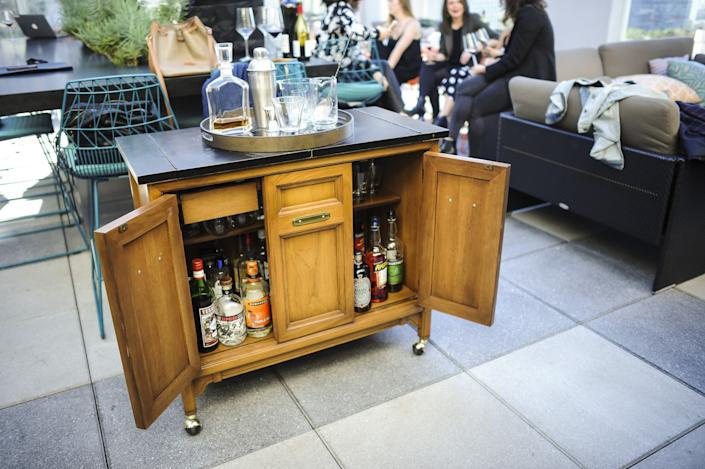 "A vintage credenza bought on Craigslist serves as a portable bar. <span class=""copyright"">(Christina House / Los Angeles Times)</span>"