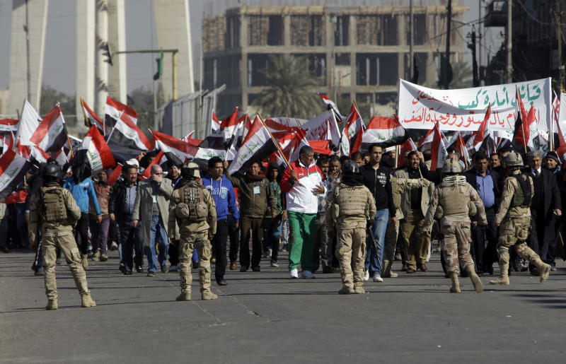 Iraqi security forces search protesters and imposed tight security measures around a downtown demonstration staged to show support for Prime Minister Nouri al-Maliki's government in Baghdad, Iraq, Saturday, Jan. 12, 2013  Shiite demonstrators are taking to the streets in Iraq's capital to show support for the prime minister who has been facing angry protests in Sunni provinces for the past three weeks as the Sunni minority protest what they call discrimination by the Shiite-led government. (AP Photo/Khalid Mohammed)