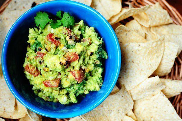 """<p>Throw some charred corn into the classic guacamole recipe, and suddenly it's doubly wonderful. If you've never made guacamole before, try cutting the avocado into dice-sized pieces inside the skin, then scoop it out with a spoon.</p><p><strong><a href=""""https://thepioneerwoman.com/cooking/grilled-corn-guacamole/"""" rel=""""nofollow noopener"""" target=""""_blank"""" data-ylk=""""slk:Get the recipe"""" class=""""link rapid-noclick-resp"""">Get the recipe</a>.</strong></p><p><strong><a class=""""link rapid-noclick-resp"""" href=""""https://go.redirectingat.com?id=74968X1596630&url=https%3A%2F%2Fwww.walmart.com%2Fip%2FThe-Pioneer-Woman-Vintage-Floral-3-Piece-Serving-Bowl-Set%2F115837521&sref=https%3A%2F%2Fwww.thepioneerwoman.com%2Ffood-cooking%2Fmeals-menus%2Fg36004463%2Fmemorial-day-appetizers%2F"""" rel=""""nofollow noopener"""" target=""""_blank"""" data-ylk=""""slk:SHOP SERVING BOWLS""""><strong>SHOP SERVING BOWLS</strong></a></strong></p>"""