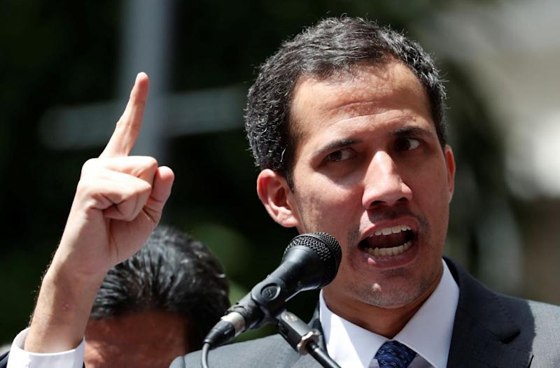 Venezuela's opposition leader Juan Guaido gestures as he speaks during a news conference in Caracas, Venezuela, January 25, 2019. REUTERS/Carlos Garcia Rawlins