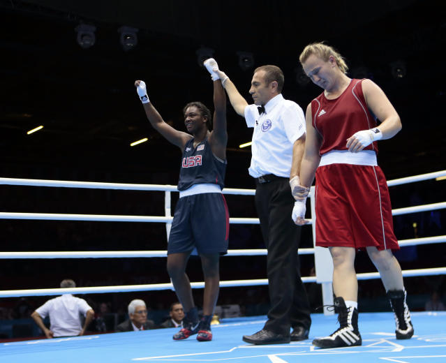 Kazakhstan's Marina Volnova, right, and Claressa Shields, of the United States react following a women's semifinal middleweight 75-kg boxing match at the 2012 Summer Olympics, Wednesday, Aug. 8, 2012, in London. (AP Photo/Ivan Sekretarev)
