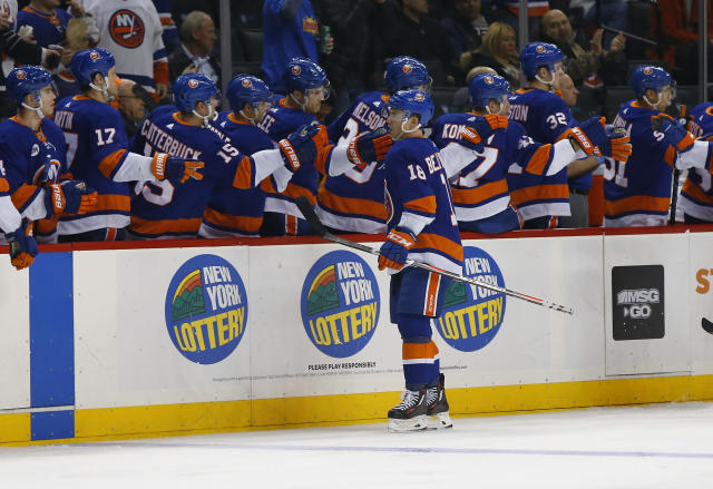 New York Islanders left wing Anthony Beauvillier (18) celebrates with teammates after scoring a goal against the Vegas Golden Knights during the first period of an NHL hockey game, Wednesday, Dec.12, 2018, in New York. (AP Photo/Noah K. Murray)