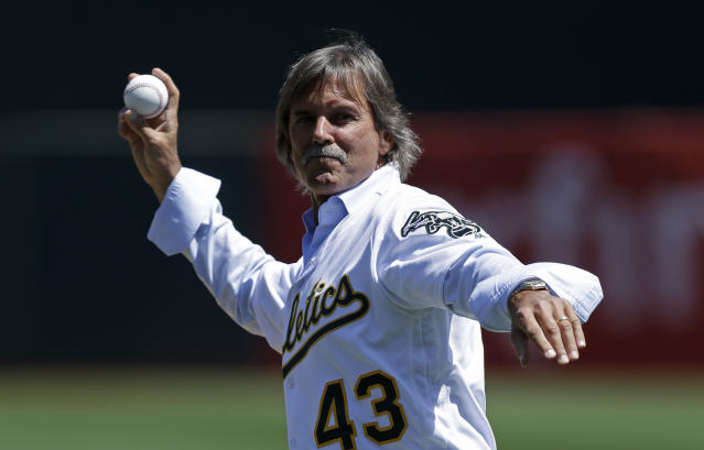 "Former <a class=""link rapid-noclick-resp"" href=""/mlb/teams/oak/"" data-ylk=""slk:Oakland Athletics"">Oakland Athletics</a> pitcher and MLB Hall of Famer Dennis Eckersley throws the ceremonial first pitch on his bobblehead day. (AP)"