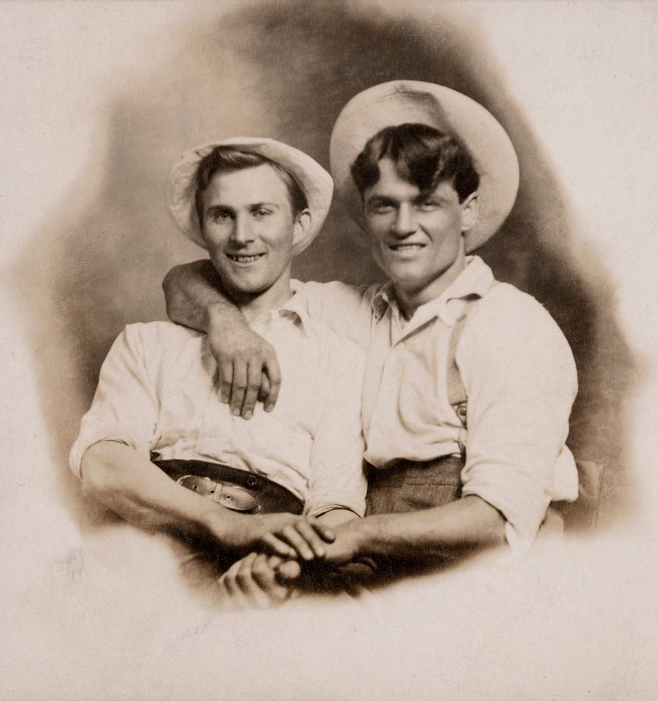 """Hugh Nini and Neal Treadwell's new book,""""Loving: A Photographic History of Men in Love, 1850s ― 1950s,"""" showcases some of the 2,800 vintage photos they've collected for 20 years. (Photo: Courtesy of the Nini-Treadwell Collection © """"Loving"""" by 5 Continents Editions)"""