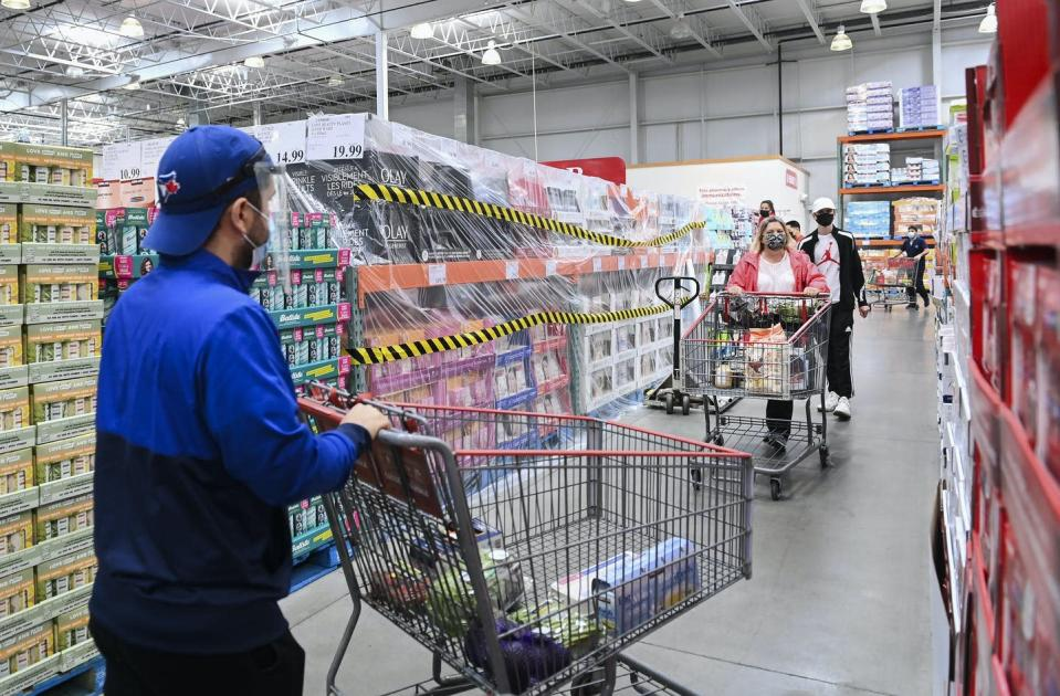 "<span class=""caption"">People in masks shop for essential items at Costco in Mississauga, Ont., on April 18, 2021. Costco insists its in-store customers wear masks even if they claim exemptions.</span> <span class=""attribution""><span class=""source""> THE CANADIAN PRESS/Nathan Denette</span></span>"