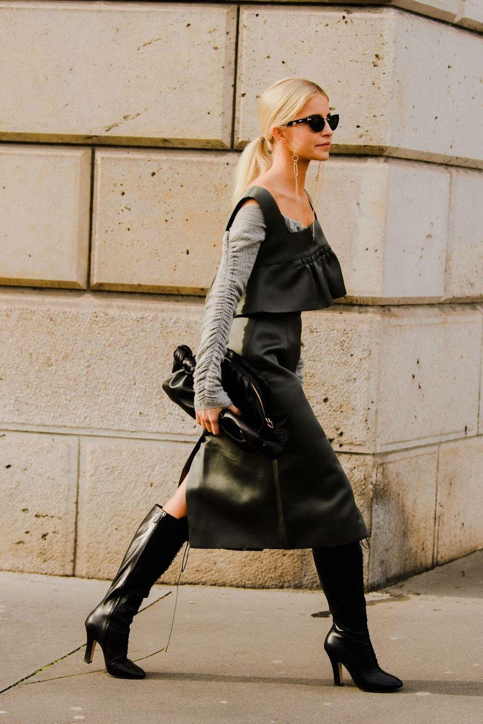 <p>Why not store your bag tote and opt for a slouchy black clutch instead? It's not like you're commuting right now anyway! </p>