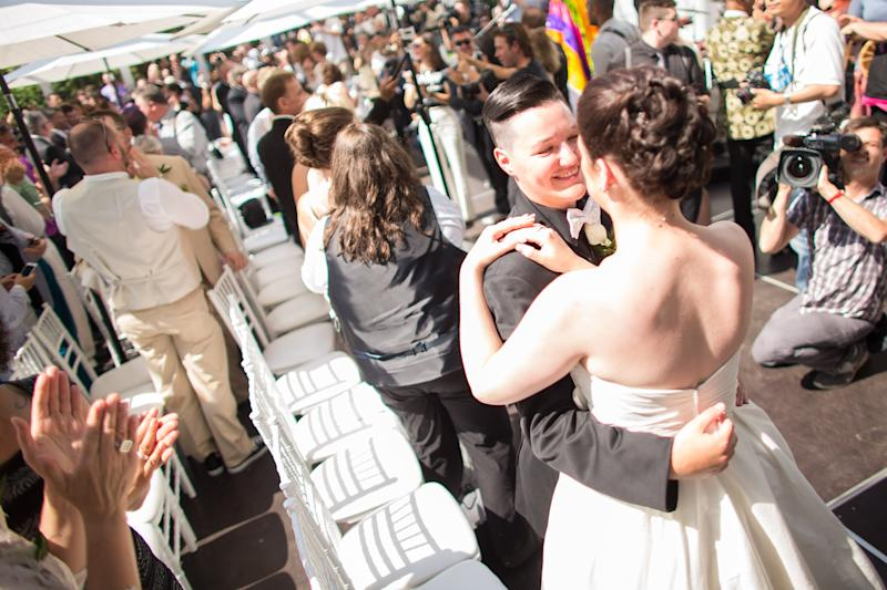 Dana Murphy (L) and Shannon St Germain dance during the Grand Pride Wedding, a mass gay wedding at Casa Loma in Toronto, Canada, on June 26, 2014 (AFP Photo/Geoff Robins)