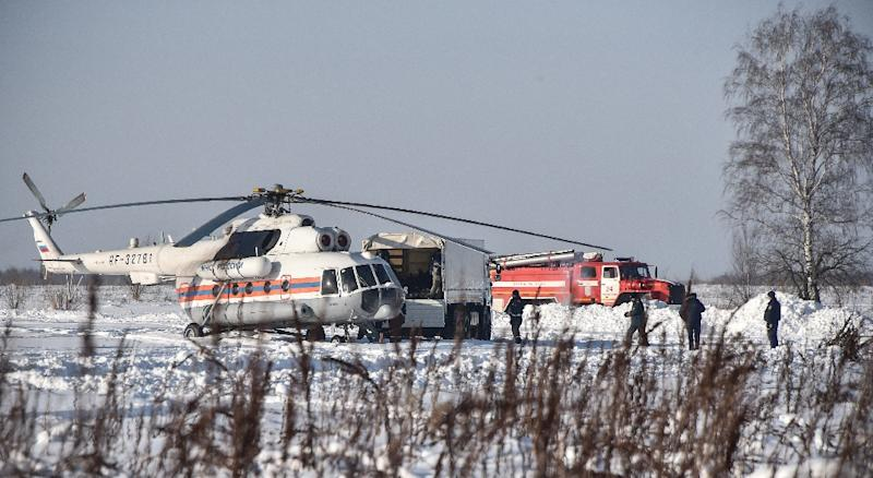Rescue work was made difficult by deep snow in the field where the Antonov An-148 plane went down near Moscow