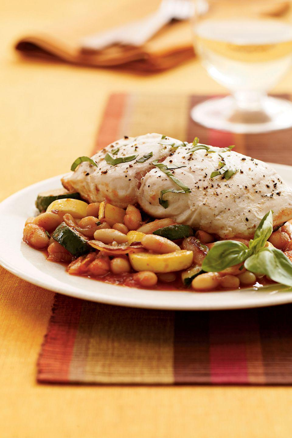 "<p>No sides are needed for this light and colorful fish dish, with striped bass atop a mix of cannellini beans, tomato sauce, rosemary, onion, squash, and garlic.</p><p><a href=""https://www.womansday.com/food-recipes/food-drinks/recipes/a9206/tuscan-bass-squash-beans-121116/"" rel=""nofollow noopener"" target=""_blank"" data-ylk=""slk:Get the Tuscan Bass with Squash and Beans recipe."" class=""link rapid-noclick-resp""><em><strong>Get the Tuscan Bass with Squash and Beans recipe.</strong></em></a></p>"