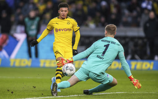 Dortmund's Jadon Sancho scores his side's opening goal during the German Bundesliga soccer match between Hertha BSC Berlin and Borussia Dortmund in Berlin, Germany, Saturday, Nov. 30, 2019. (Andreas Gora/dpa via AP)