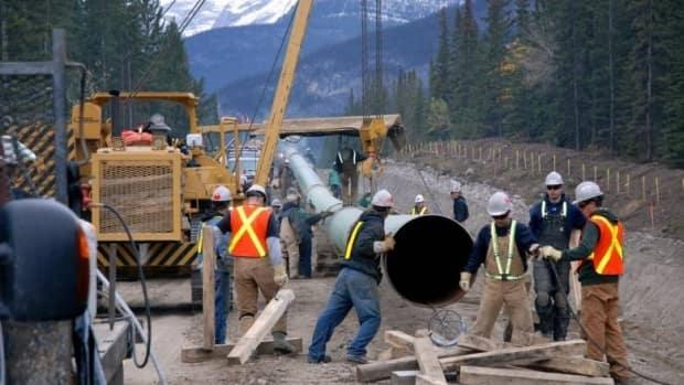 Trans Mountain says it is taking additional measures to contain the spread, including more rapid testing, reinstating mask mandates for those in close contact and implementing increased sanitation procedures. (CBC - image credit)