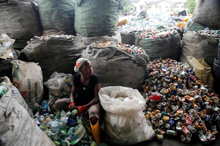 <p>A woman sorts waste at the Wecycler waste recycling centre in Ebutte Meta district in Lagos, Nigeria July 28, 2016. (Photo: Akintunde Akinleye/REUTERS)</p>